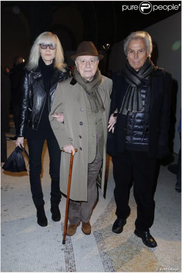 Betty Catroux et son mari Francois Catroux entourent Pierre Berge Presentation de la collection Homme Yves Saint Laurent au Grand Palais, à Paris le 20 janvier 2013